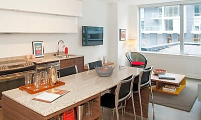dining space with hardwood floors, a healthy amount of sunlight, a kitchen bar, electric range oven, dishwasher, and TV, City Market At O Street, 0