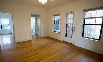 wood floored empty room featuring a ceiling fan and a healthy amount of sunlight, 5202-5210 S. Cornell Avenue, 1