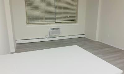 hardwood floored spare room featuring baseboard radiator, YoNo, 2