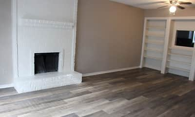 hardwood floored living room with a ceiling fan and a brick fireplace, Springwood Park, 2