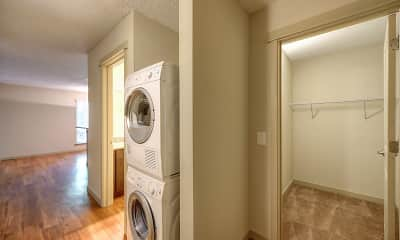 laundry area featuring hardwood floors and separate washer and dryer, The Retreat, 2