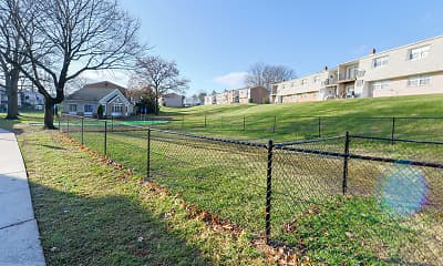 view of nearby features featuring an expansive lawn, Sherry Lake Apartments, 2