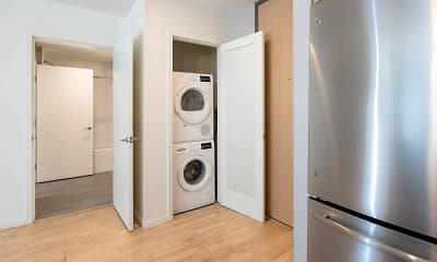 washroom with hardwood flooring, stainless steel refrigerator, and separate washer and dryer, Girard, 2