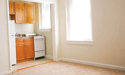 kitchen featuring carpet, natural light, refrigerator, range oven, brown cabinetry, and light floors, New Brunswick Arms Apartments, 2
