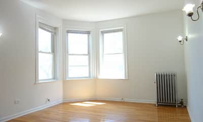 wood floored spare room featuring plenty of natural light and radiator, 4720 S Drexel Boulevard, 1