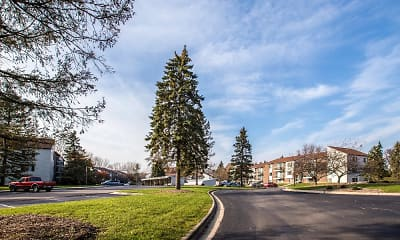 view of street with a lawn, Okemos Station Apartments Townhomes, 0