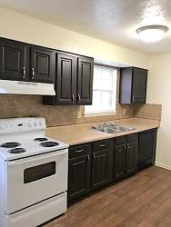 Updated Kitchens with Tile Backsplash and Hardwood Style Flooring