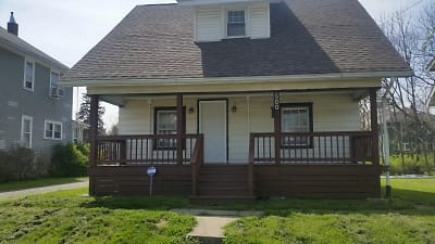 580h front of house with new porch.jpg