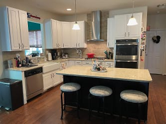 Quartz Countertops, Convection Double-Oven, 5 Burner Gas Range with Vent Hood, Garbage Disposal