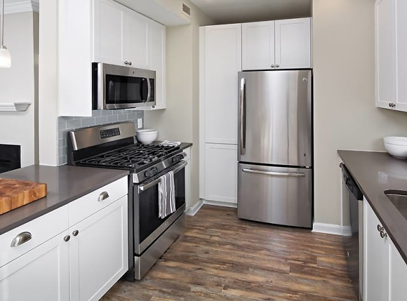 Kitchen with Stainless Steel Appliances and Quarts Countertops
