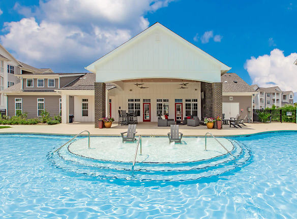 SOAK UP THE SUN BY OUR SHIMMERING SWIMMING POOLS