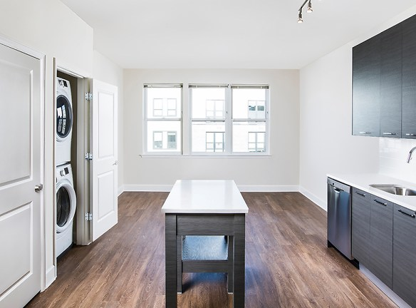 Fully Functional Kitchen with Island and Stackable Front Loading Washer/Dryer