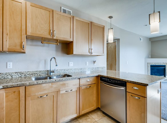 Open kitchen/dining room floor plan with granite countertops and stainless steel appliances!