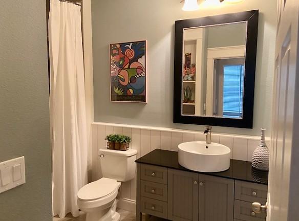 Bath w. porcelian tile floors, tile surround new tub:shower shiplap walls, high end vanity, waterfall faucet, .jpg