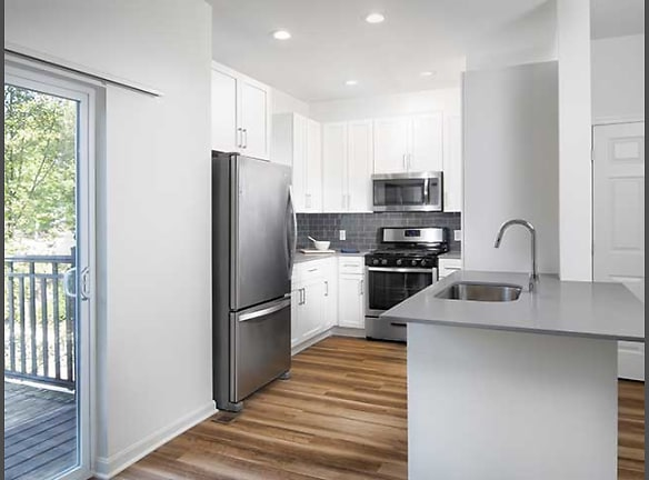 Newly Renovated Kitchen Quartz Countertops and New Cabinetry (in Select Homes)