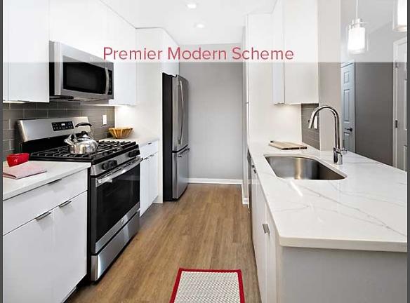 Premier Scheme Kitchen with Hard Surface Flooring and Stainless Steel Appliances