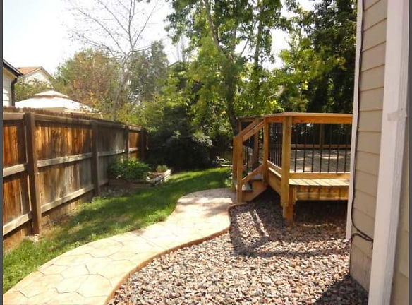 Backyard with Stamped Concrete Walkway