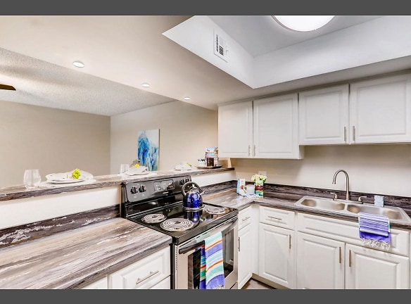 Kitchens feature a breakfast bar overlooking the dining and living rooms.