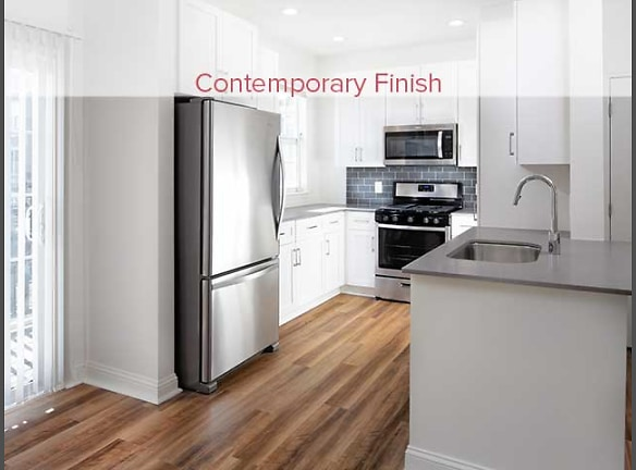 Newly renovated kitchen with hard surface plank flooring (in select homes)