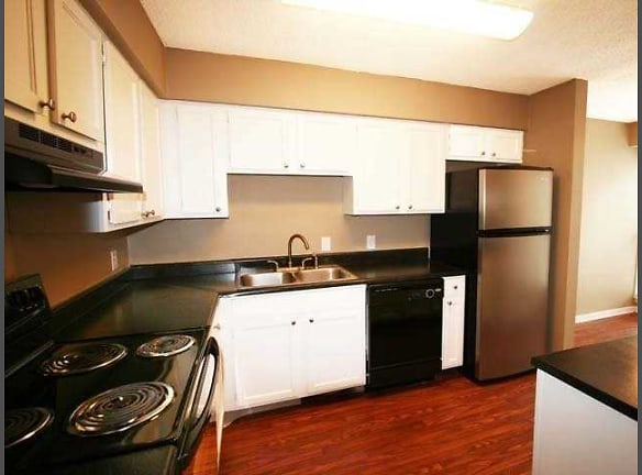 Newly Redesigned Kitchen boasting White Cabinets with Brushed Nickel Accents