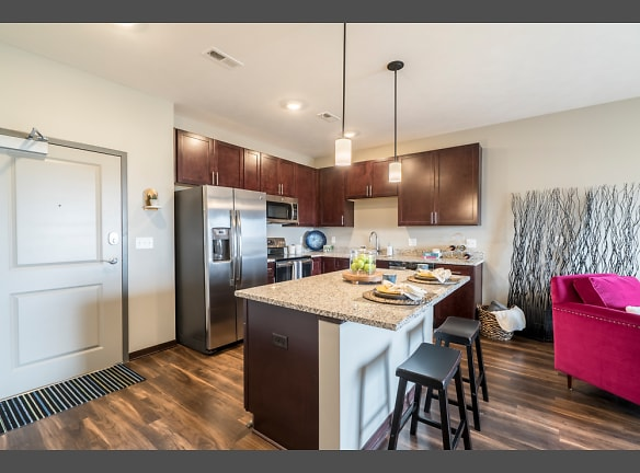 Our kitchens feature dark cabinetry, stainless steel appliances, pendant lighting and often a kitchen island.