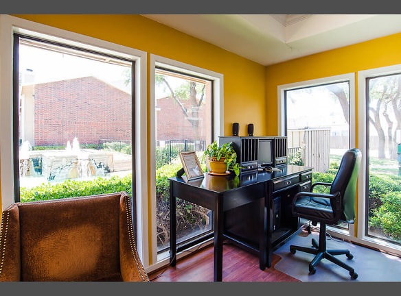 A desk and chairs in the leasing office overlooking the property