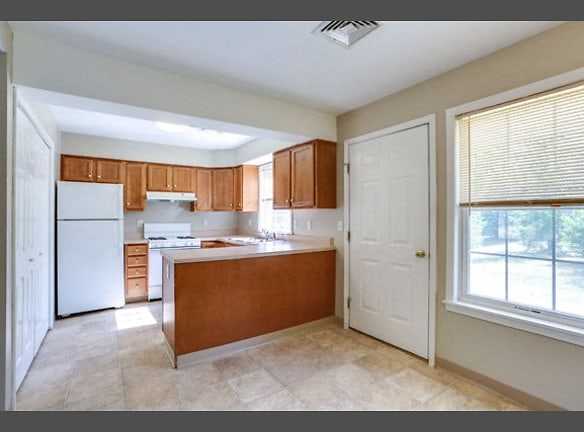3 Bedroom Unit - Kitchen and Dining Area - All Appliances Included