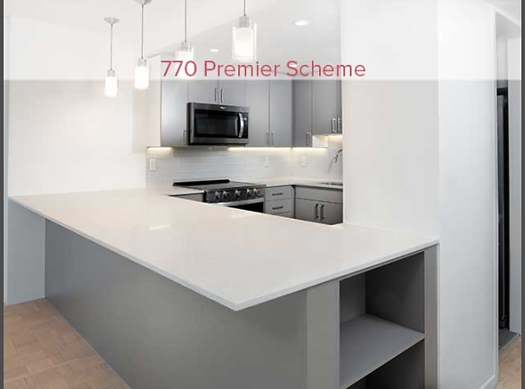 770 Premier Scheme kitchen with quartz countertops, new cabinetry, tile backsplash, and stainless steel appliances (in select homes)