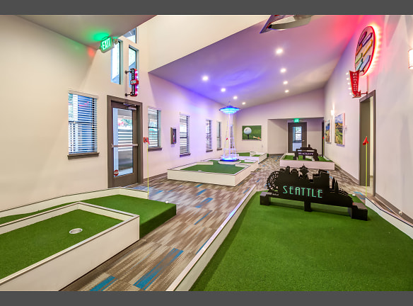 9 holes of Indoor/Outdoor Miniature Golf