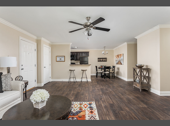 Open Concept Renovated Living and Dining Room - Live Oak Trace Apartments