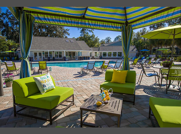 Relax by the pool under the poolside cabanas.