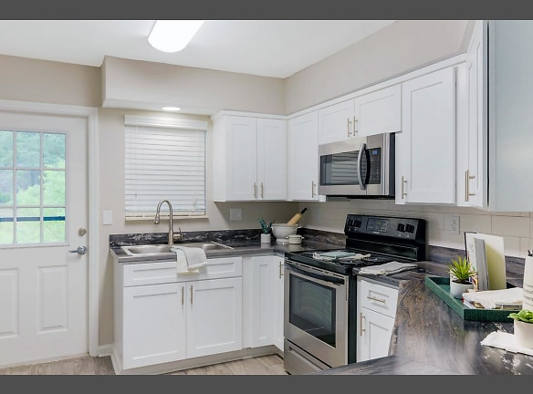 Open concept kitchens featuring wood-style flooring and breakfast bar.