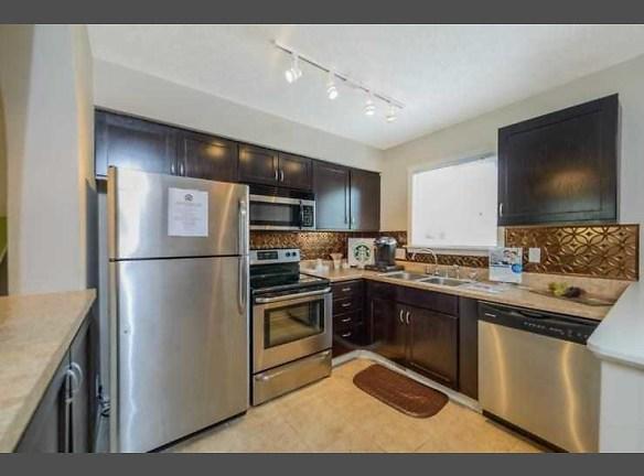 All stainless steel appliances, cooper backsplash highlight the modern open kitchen.
