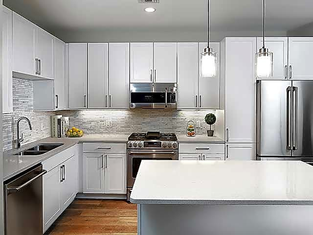 Signature Collection Home Kitchen with GE Cafe Series Stainless Steel Appliances
