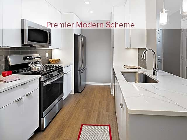 Premier Scheme Kitchen with Hard Surface Flooring and Stainless Steel Appliances