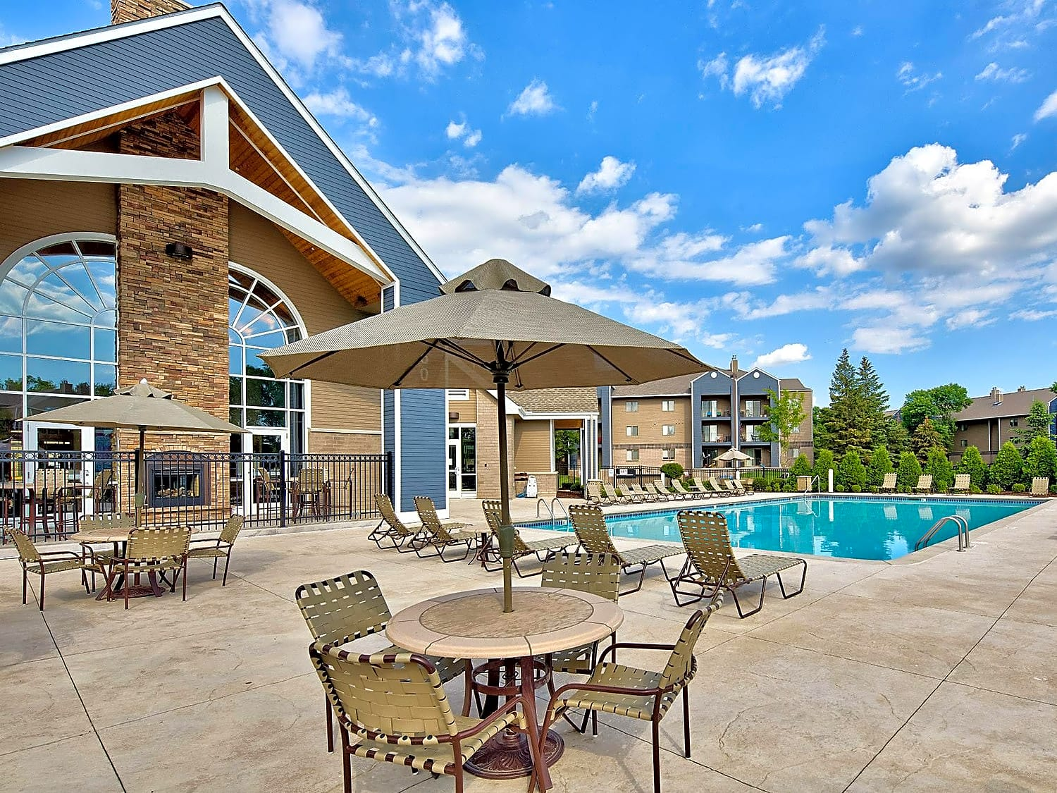 A sparkling resort-style pool sits just outside the clubhouse with plenty of outdoor seating.