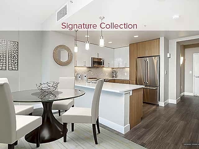 Signature Collection Dining and Kitchen Area with Hard Surface Vinyl Plank Flooring
