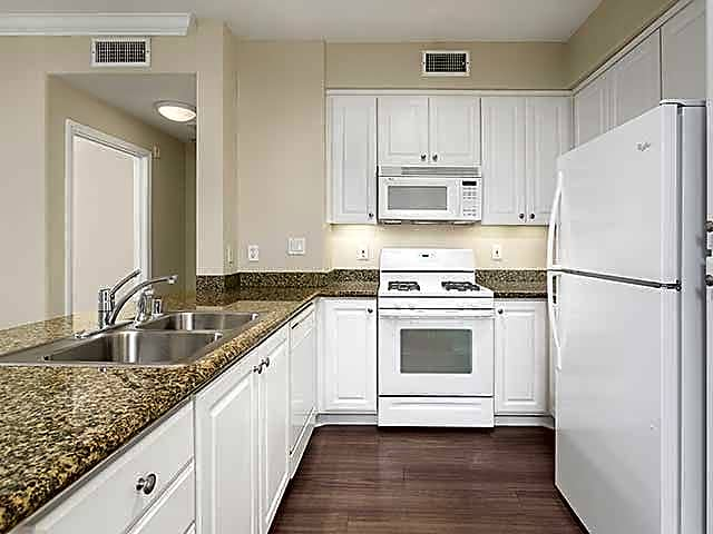Kitchen with hard surface plank flooring (in select homes)