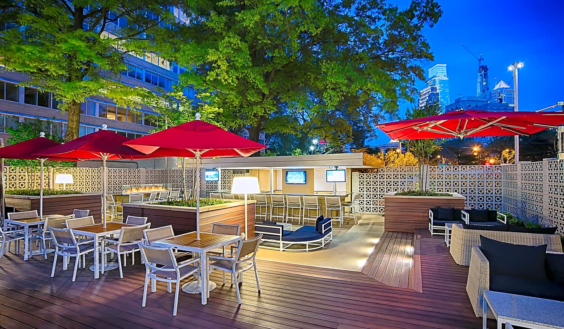 Meet up with friends at the Skyline Lounge with outdoor TV's, bar area, and fire pit