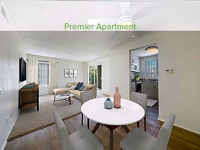 Premier living, dining, and kitchen area (in select homes)