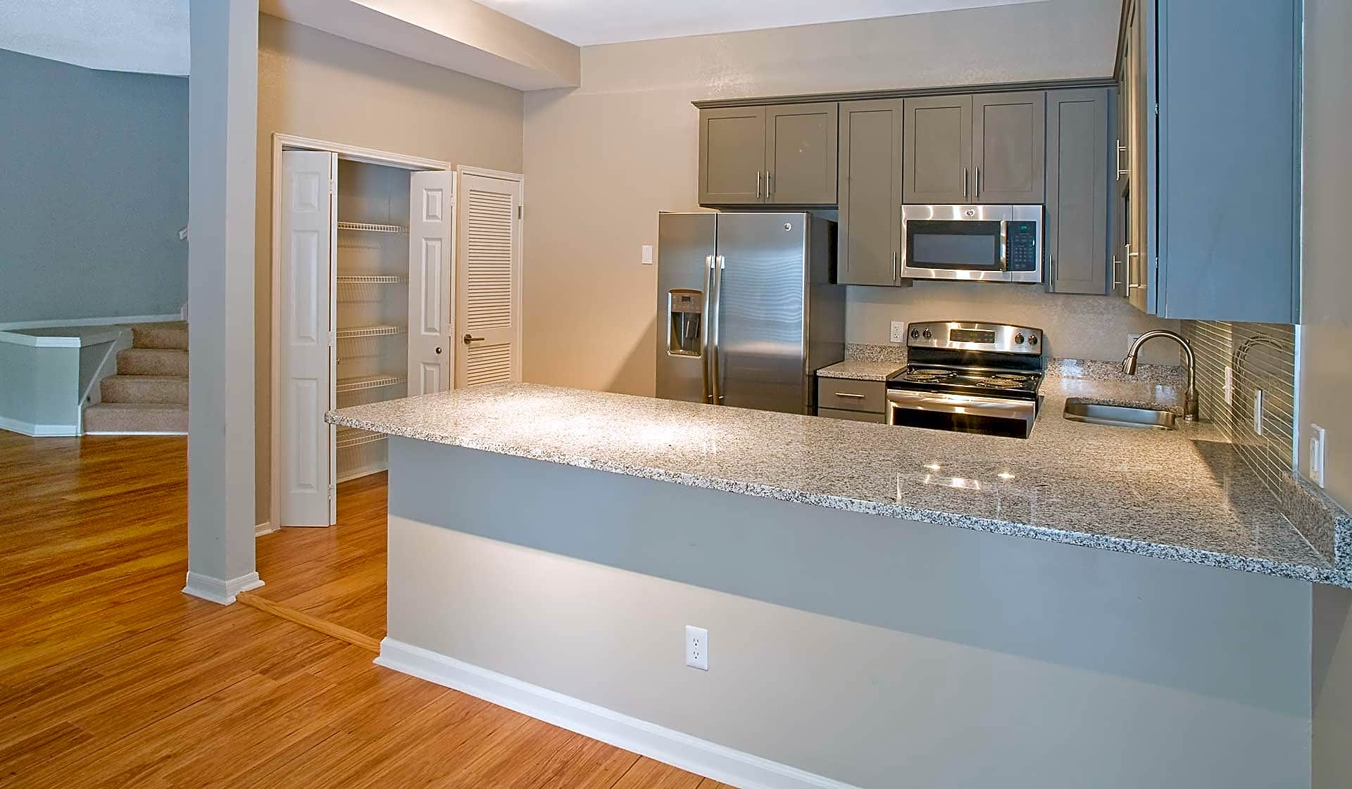 Designer kitchen with stainless steel appliances, granite countertops and premium cabinetry in select homes