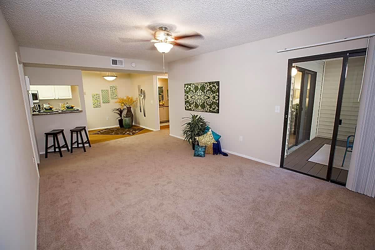 Spacious living rooms featuring a ceiling fan and sliders to your private patio/balcony.