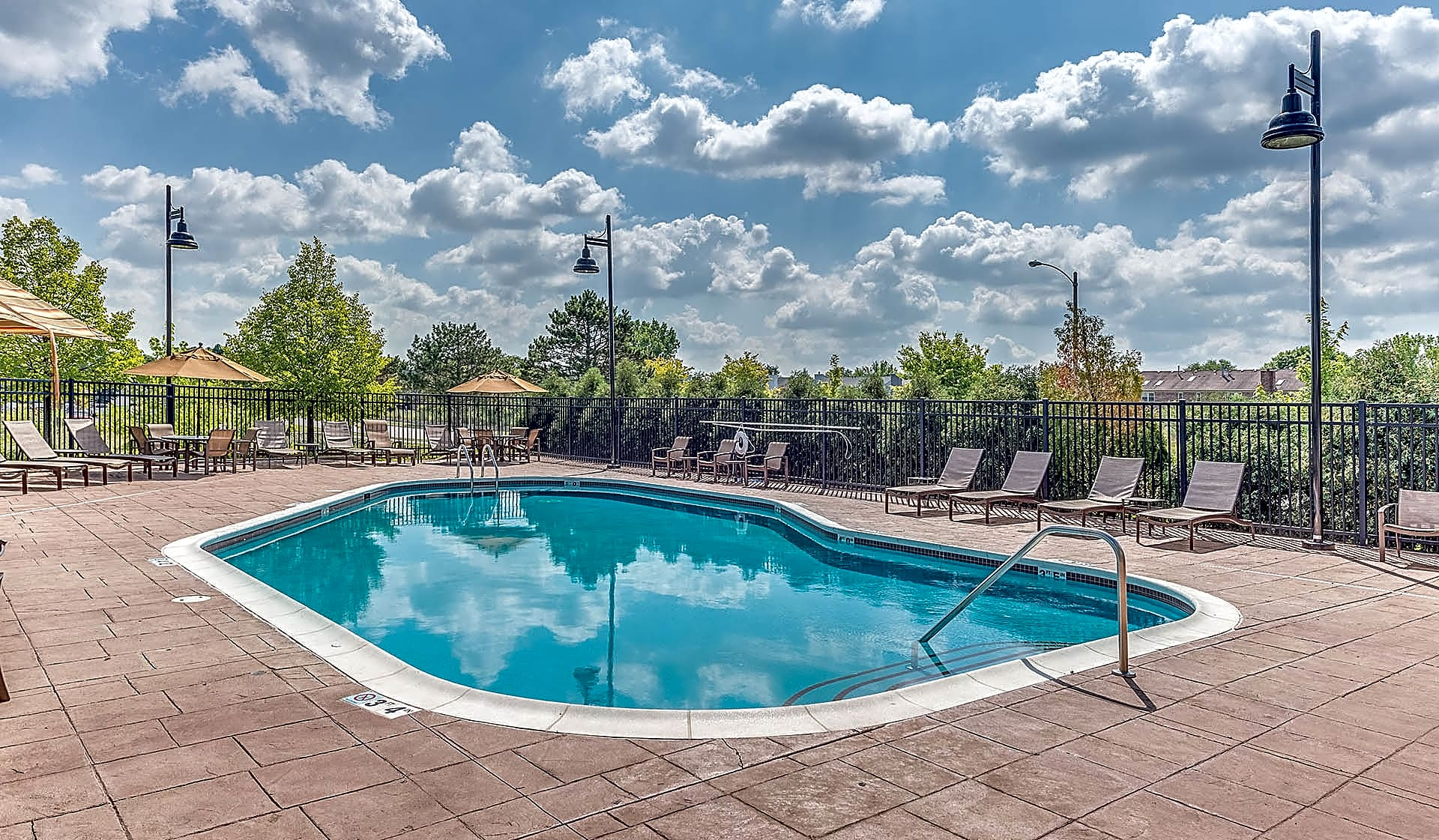 Beautiful heated pool with expansive sundeck