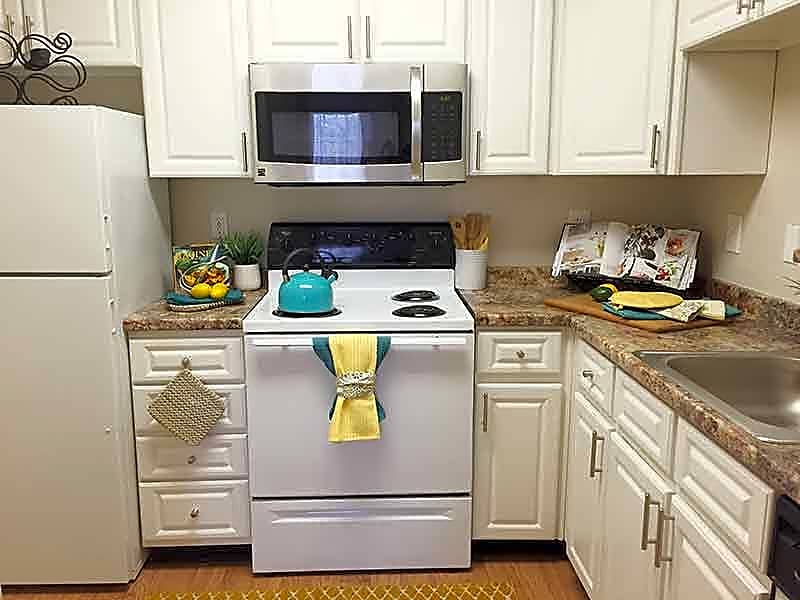 Newly remodeled kitchens with granite-style counters and stainless steel appliances.