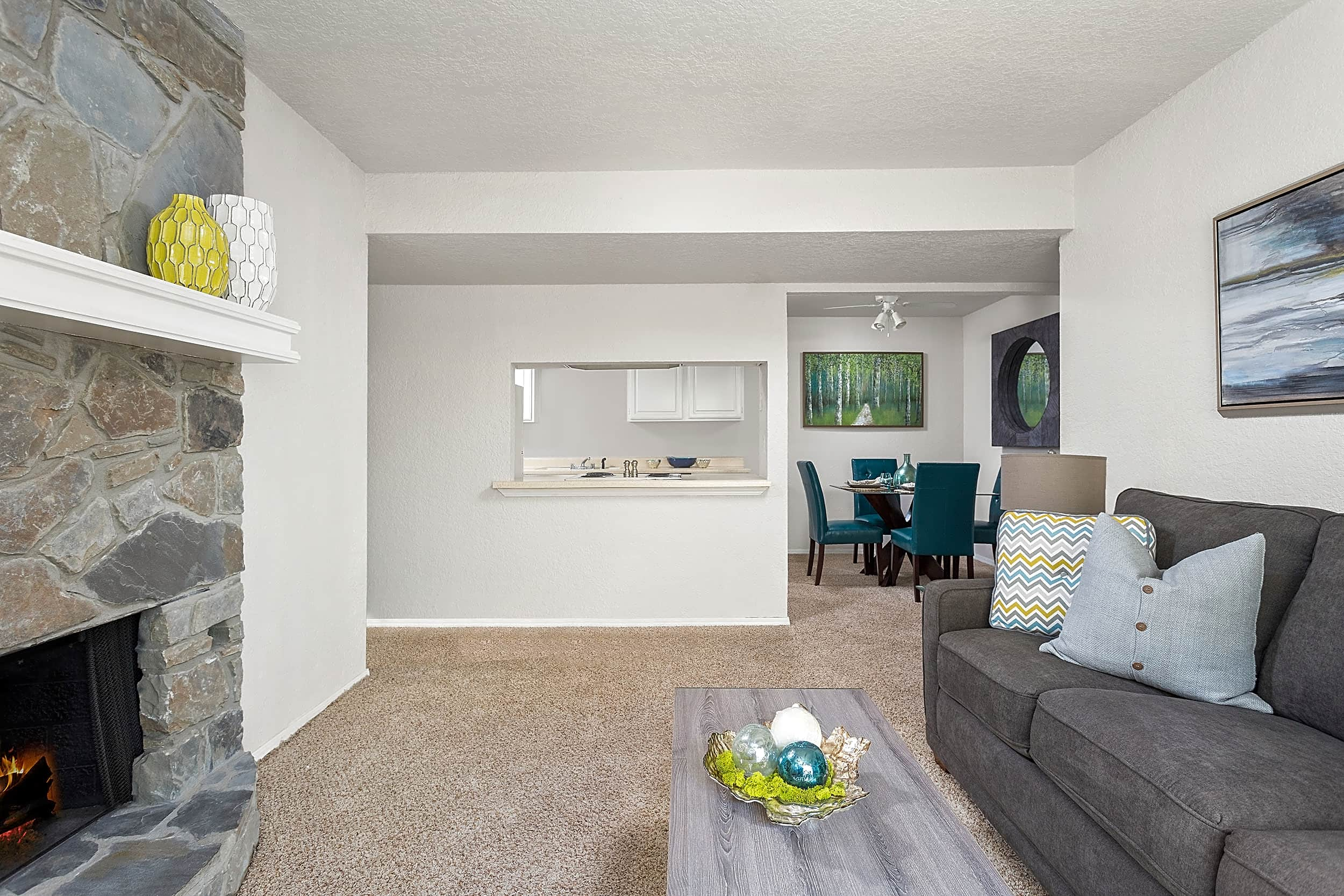 Living Room with Fireplace - Windrush Apartments