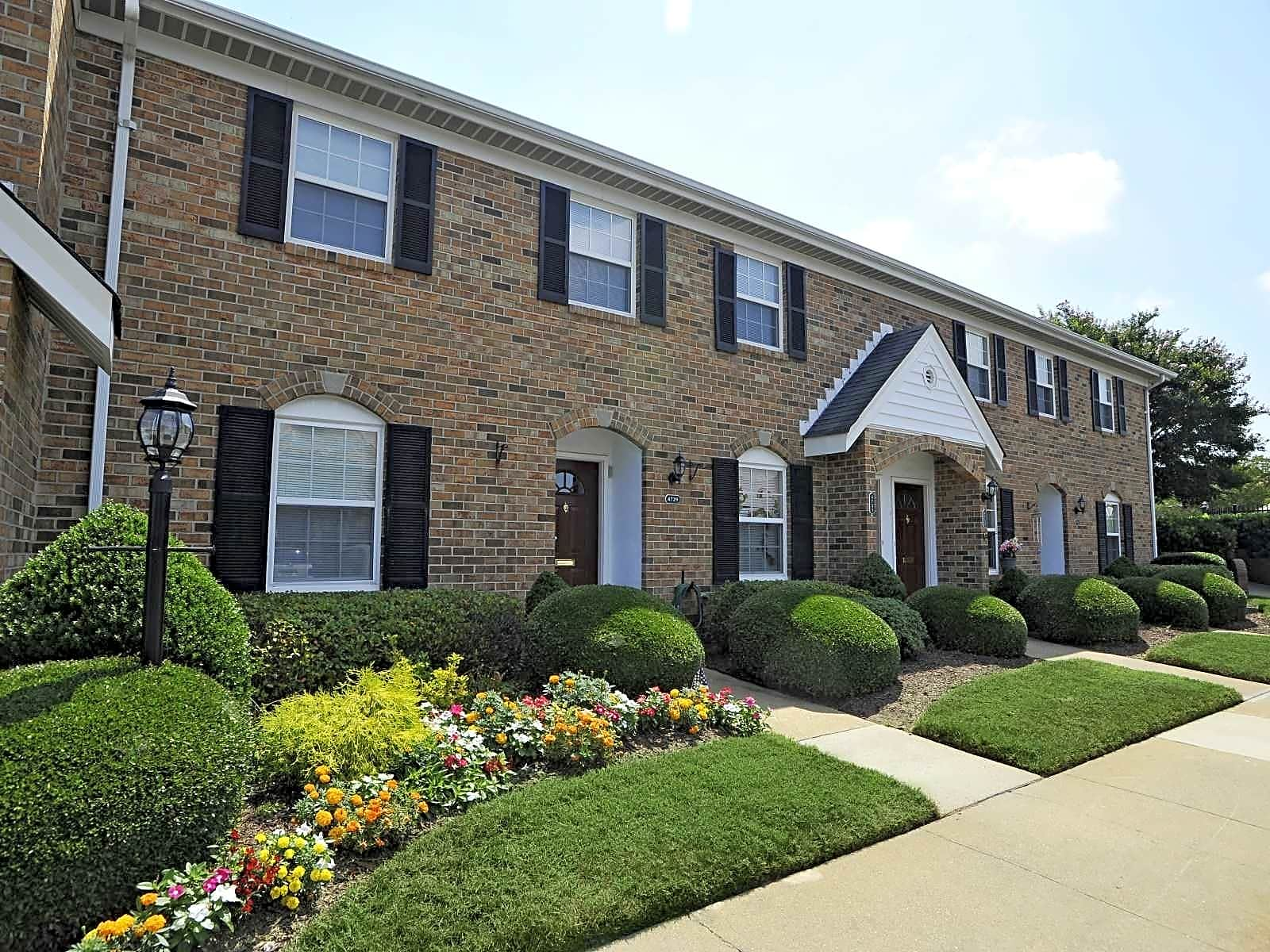 Brick exteriors with lush landscaping