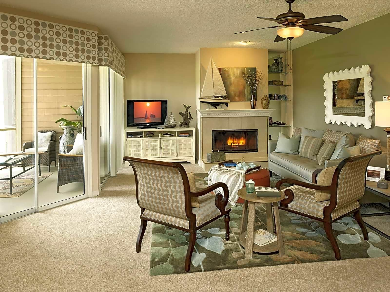 Living room with screened patio or balcony