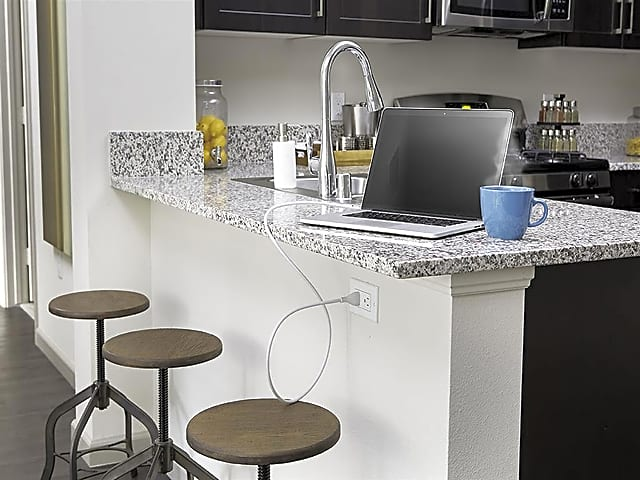 Prep and create on durable luxury. Kitchens and baths at Skye have creamy polished granite countertops.