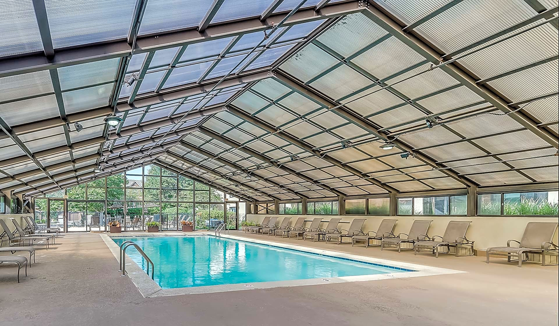 Large swimming pool with retractable roof