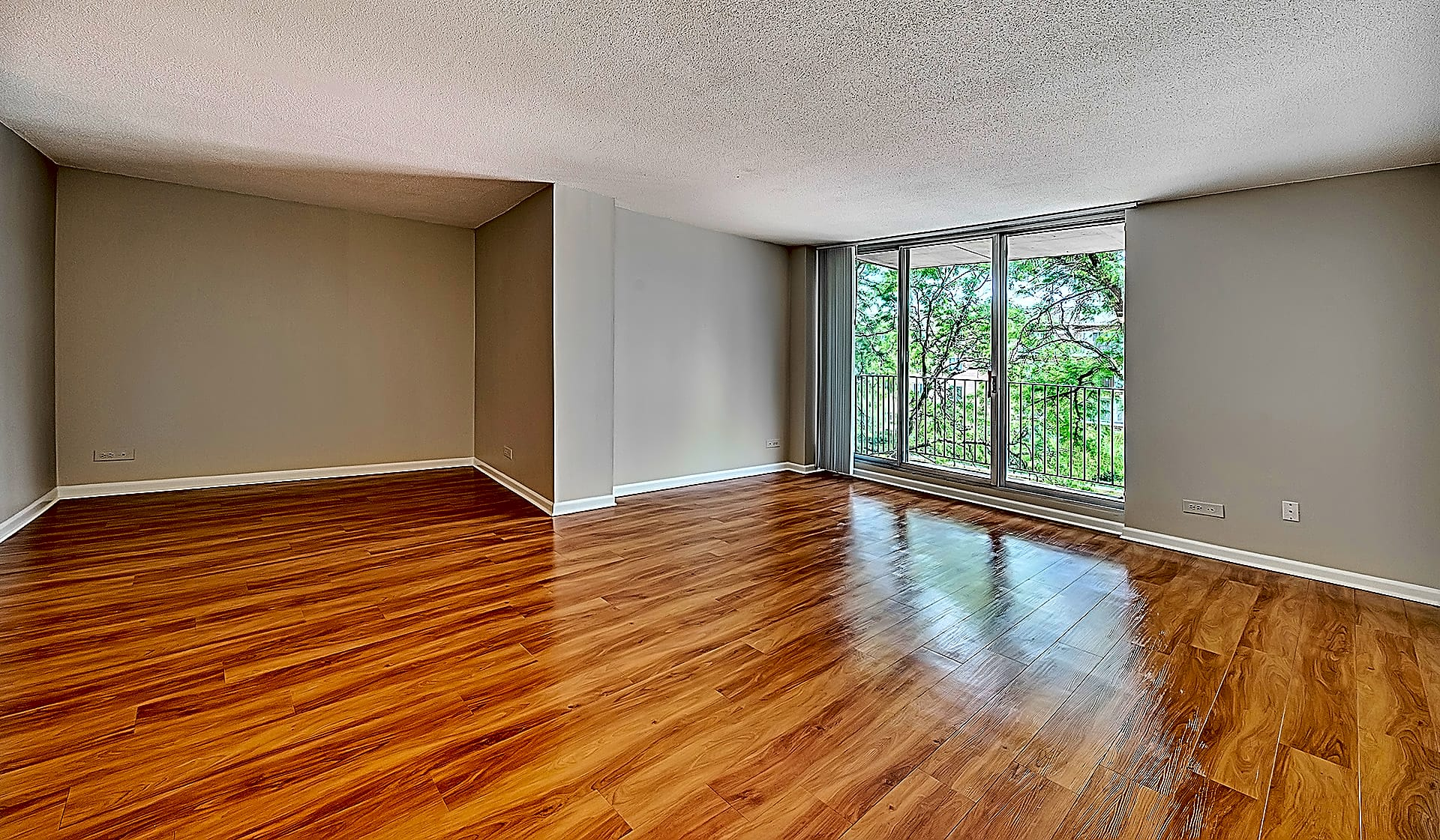 Large living space with wood flooring